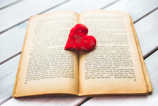 Red heart on a book